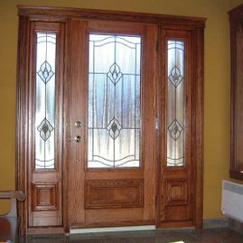Set of steel doors with two side panels and interior cherrywood finish